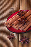 Cinnamon with anise on a wooden background — Stock Photo