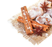 Cookies with anise stars and cinnamon on sacking — Stock Photo