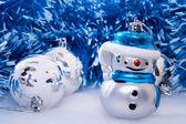 Vánoční pozadí s veselého sněhuláka — Stock fotografie