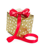 Gift in gold box with a red bow. Isolate on white background — Stock Photo