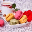 French macarons with coffee and flowers — Stock Photo #36919001