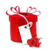 Red gift with a red bow and roses. Isolate on white background — Stock Photo