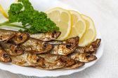 Smoked sardines with lemon and herbs. — Stockfoto