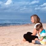 Woman and little boy quarrel on the ocean coast — Stock Photo
