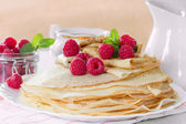 Homemade pancakes with raspberries and mint — Stock Photo