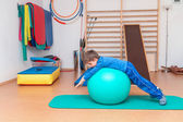Child is therapeutic exercises in the gym  — Stock Photo