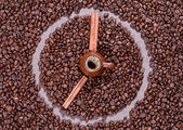 Coffee beans in the form of clock — Stock Photo