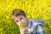 Portrait of a boy on a rapeseed field — Stock Photo