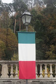 Italian flag hanged on lamp post — Stock Photo