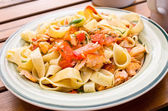 Tagliatelle with salmon — Stock Photo