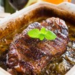 Roasted piece of lamb meat gravy — Stock Photo