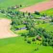 Village in the agricultural terrain — Stock Photo