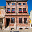 Stock Photo: Old brick-made tenement house