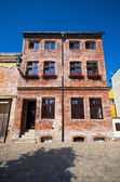 Old brick-made tenement house — Stock Photo