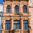 Stock Photo: Tenement house with statues