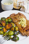 Beef steak with garlic butter and brussel sprouts — Photo