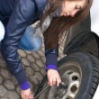 Young woman during the wheel changing — Stock Photo #7929210