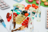 Lot of medicines, syringe and thermometer — Stock Photo
