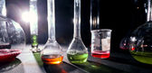 Group of laboratory flasks with a colored liqiuds — Stock Photo