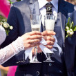 Glasses with champagne in hands — Foto de stock #13729786