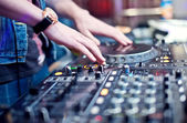 Dj mixing in night club — Stock Photo