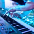 Man playing the synthesizer keyboard — Stock Photo #28827771