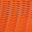 Foto Stock: Weaved plastic chair detail