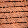 Red roof tiles background — Stock Photo