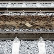 Iron rusty train railway detail over dark stones rail way — Stock Photo