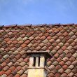 Red brick chimney on tile roof — Stock Photo