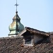 Belfry behind a roof — Stock Photo