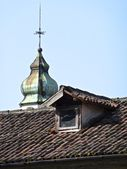 Belfry behind a roof — Stockfoto