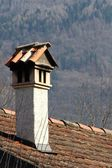Chimney on the top of a tiles roof — Stock Photo