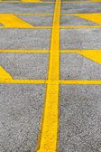 Yellow and gray road asphalt lines detail — Stock Photo