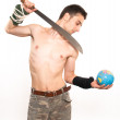 Young fighter holding a machete — Stock Photo