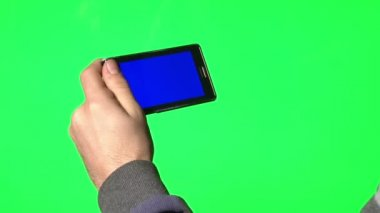 Man using smartphone with a blue screen to add your own custom content — Stock Video