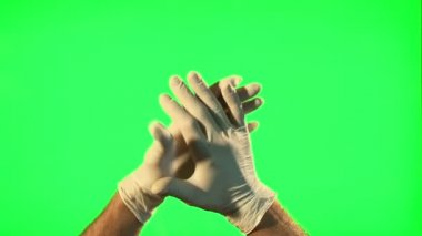 Male hands with surgical gloves clapping on green screen — Video Stock