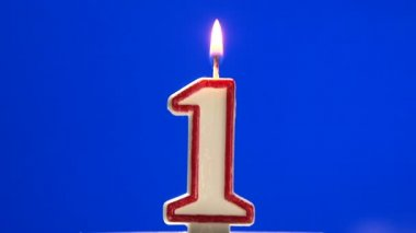 Number 1 - one birthday candle burning - blow out at the end — Stock Video