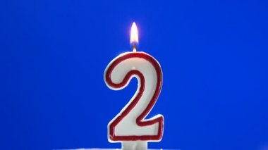 Number 2 - two birthday candle burning - blow out at the end — Stock Video