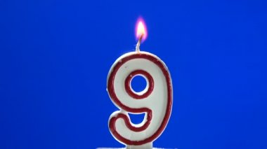 Number 9 - nine birthday candle burning - blow out at the end — Stock Video