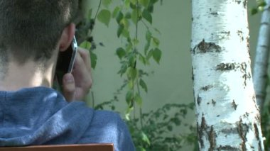 Eco concept - teenager charging smartphone from tree — Stock Video