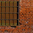 Background of Old Brick Wall with Rusty Metal Window — Stock Photo #25119079
