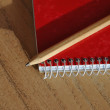 Stock Photo: Pencil and notebook
