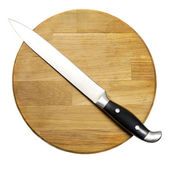 Large kitchen knife on a wooden board — Stock Photo