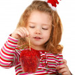 Little girl holding a red apple — Stock Photo