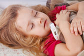 Little girl lying in bed — Stock Photo