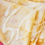 Pancakes with condensed milk — Stock Photo