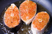 Frying fresh salmon on the pan — Stok fotoğraf