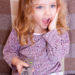 Little girl watching TV — Stock Photo