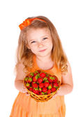 Happy little girl with strawberries — Stock Photo
